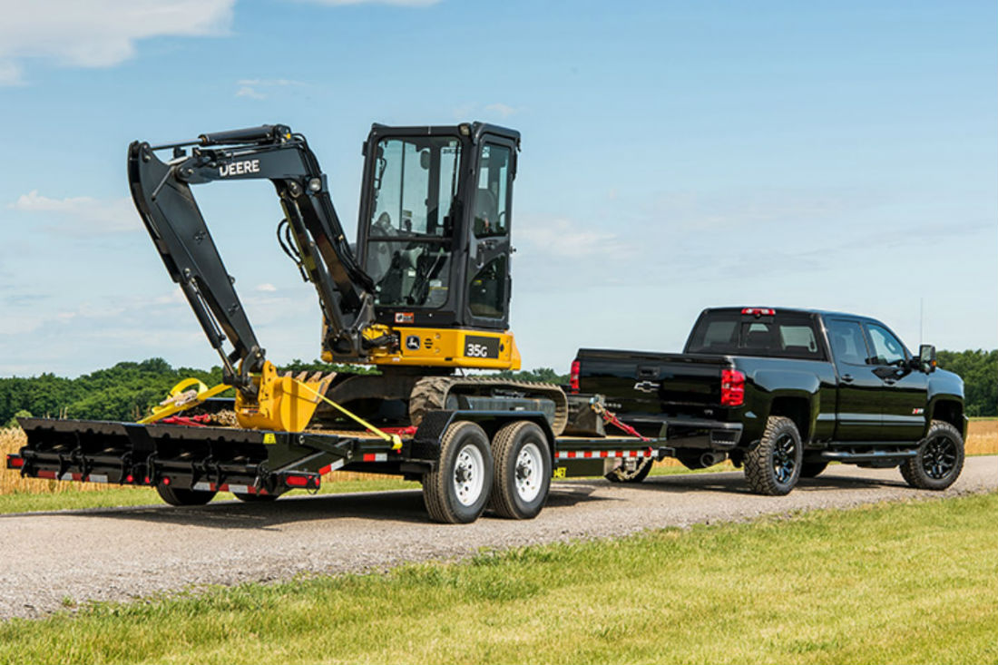 hight resolution of 2018 chevy silverado 2500 hd towing a piece of heavy equipment