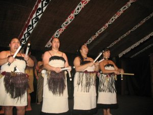 women maori dancers with sticks