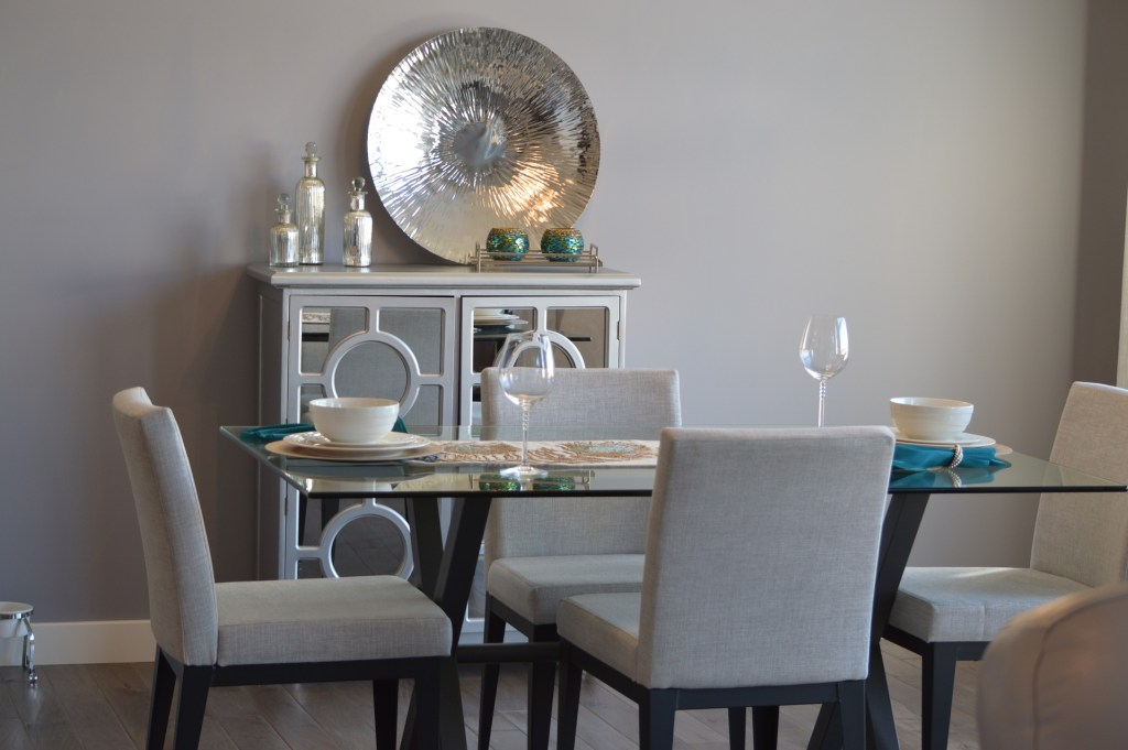 A dining room with metallic decor