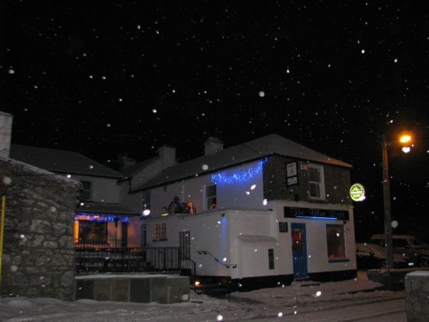 The Blue Light pub at night in the snow