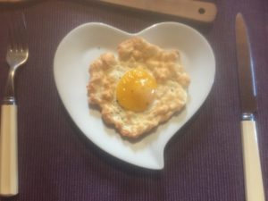 Finished fluffy egg cloud on heart shaped plate