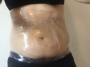 Cling wrap around the midriff
