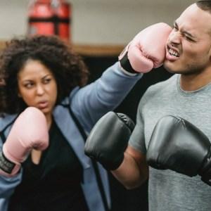 woman boxing man