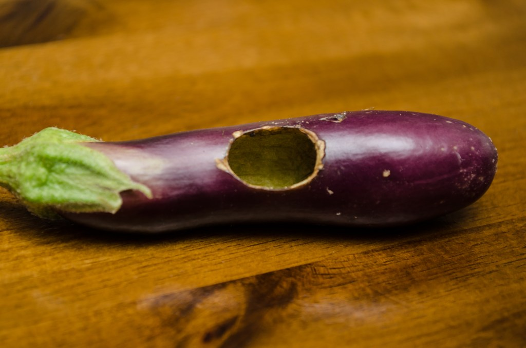 Eggplant with hole in it closer