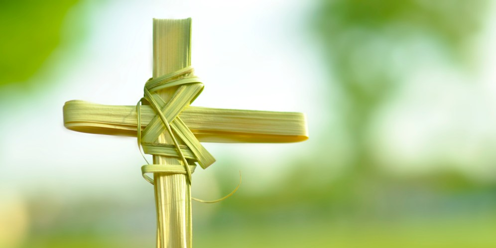 Cross made out of palm fronds.