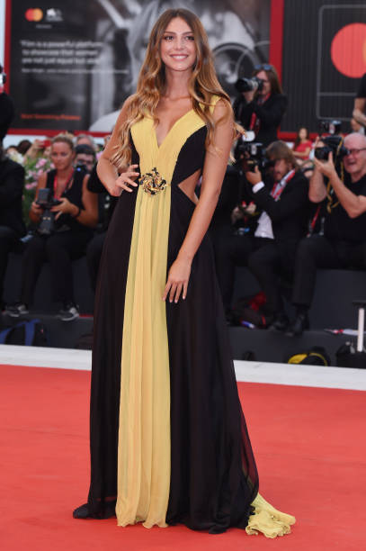 """VENICE, ITALY - SEPTEMBER 02: Arianna Cirrincione walks the red carpet ahead of the """"Martin Eden"""" screening during the 76th Venice Film Festival at Sala Grande on September 02, 2019 in Venice, Italy. (Photo by Stefania D'Alessandro/WireImage,)"""