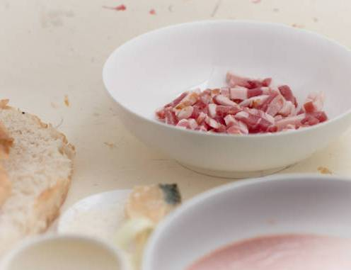 White bowl with lardons. Kitchen area.