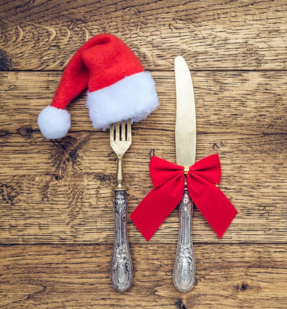 Empty wooden rustic table served with fork and knife and Christmas decoration