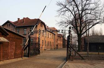 """OSWIECIM, POLAND- DECEMBER 8: An exterior view of The Auschwitz complex, December 8, 2004 showing the entrance gates to Auschwitz I with the words """"Arbeit Macht Frei"""" (Work Makes One Free) over head. The camp was liberated by the Soviet army on January 27, 1945, January 2005 will be the 60th anniversary of the liberation of the extermination and concentration camps, when survivors and victims who suffered as a result of the Holocaust will commemorated across the world. (Photo by Scott Barbour/Getty Images)"""