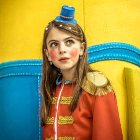 A young reveler dances on a float during the children carnival parade in Sitges. (Photo by Matthias Oesterle/Corbis via Getty Images)