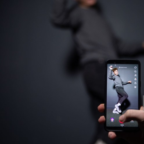 An AFP collaborator poses for a picture using the smart phone application TikTok on December 14, 2018 in Paris. - TikTok, is a Chinese short-form video-sharing app, which has proved wildly popular this year. (Photo by - / AFP) (Photo credit should read -/AFP via Getty Images)