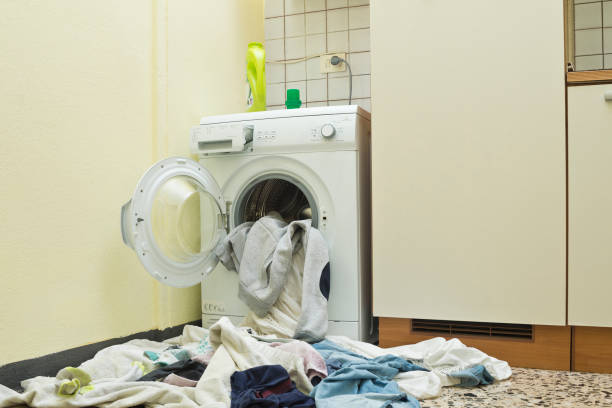 Washing spilling from domestic washing machine At Home