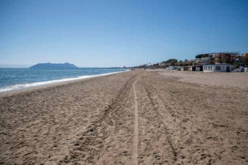 TERRACINA, ITALY - MAY 06: A general view of an empty beach about 100 km (80 miles) south of Rome during the third day of the so called phase two due to the Coronavirus (Covid-19) pandemic, on May 6, 2020 in Terracina, Italy. Italy was the first country to impose a nationwide lockdown to stem the transmission of the Coronavirus (Covid-19), and its restaurants, theaters and many other businesses remain closed. (Photo by Antonio Masiello/Getty Images)