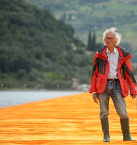 """Artist Christo Vladimirov Javacheff walks on his monumental installation """"The Floating Piers"""" he created with late Jeanne-Claude, on June 16, 2016 during a press preview at the lake Iseo, northern Italy. Some 200,000 floating cubes create a 3-kilometers runway connecting the village of Sulzano to the small island of Monte Isola on the Iseo Lake for a 16-day outdoor installation opening on June 18. / AFP / Filippo MONTEFORTE / RESTRICTED TO EDITORIAL USE - MANDATORY MENTION OF THE ARTIST UPON PUBLICATION - TO ILLUSTRATE THE EVENT AS SPECIFIED IN THE CAPTION (Photo credit should read FILIPPO MONTEFORTE/AFP via Getty Images)"""
