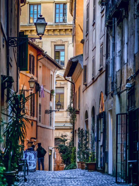 Rome, Italy, Feb 13, 2019 - A view of the Jewish ghetto of Rome, the second oldest in the world after the Venetian ghetto, located in the area bordered by the imperial ruins of the Teatro di Marcello, the Synagogue, the Tiber River and Via Arenula. In the photo a view of Via della Reginella from Piazza Mattei