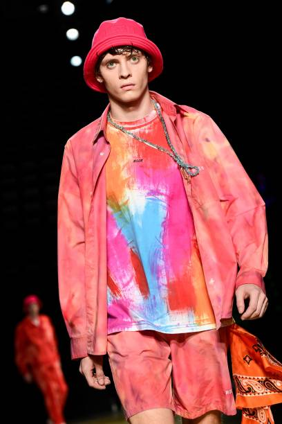 A model presents a creation during the presentation of Italian fashion brand MSGM's Spring-Summer 2020 collection, as part of a Pitti Special Anniversary to celebrate the brand's 10 years, during the Pitti Immagine Uomo fashion fair at the Mandela Forum in Florence on June 13, 2019. (Photo by Miguel MEDINA / AFP) (Photo credit should read MIGUEL MEDINA/AFP via Getty Images)