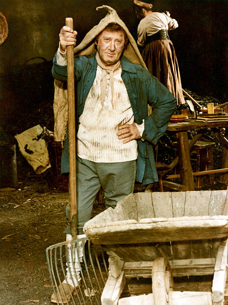 Italian actor and director Alberto Sordi holding a pitchfork acting in the film The Marquis of Grillo. 1981. (Photo by Mondadori via Getty Images)