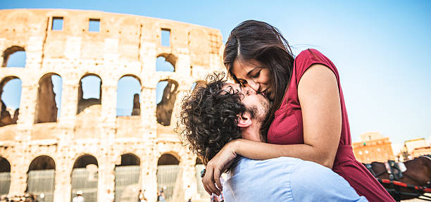 Tourist flirting in rome at coliseum