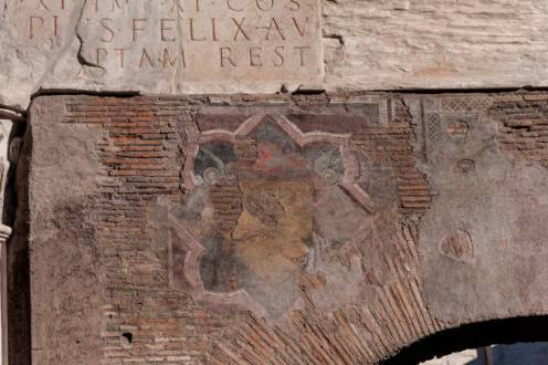 ROME, ITALY - DECEMBER 18: Inaugurated the restoration of the Portico d' Ottavia, the third phase just concluded with the cleaning, restoration and consolidation of the stone parts, plaster and frescoes: part of the inscription dedicated to Septimius Severus, and part of the fourteenth-century frescoes (in the picture) above the frontal arch, have been brought back to their former splendour on December 18, 2017 in Rome, Italy. The complex of the portico d' Ottavia was rebuilt by Augustus between 27 and 23 BC, in place of the oldest portico of Metello and dedicated to his sister Ottavia. It was later restored and partially rebuilt in 203 by Septimius Severus after the destruction caused by a fire in 191. (Photo by Stefano Montesi - Corbis/Corbis via Getty Images)