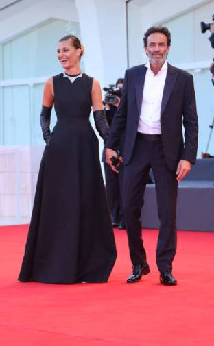 Anthony Delon, Sveva Alviti pose on the red carpet with the Golden Lion Lifetime achievement award after the Opening Ceremony during the 77th Venice Film Festival on September 02, 2020 in Venice, Italy. (Photo by Matteo Chinellato/NurPhoto via Getty Images)