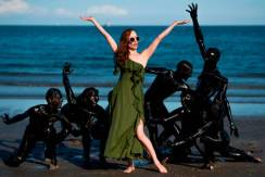 "Dutch actress Lotte Verbeek and the cast of ""The Book Of Vision"" recreate a scene from the movie during the 77th Venice Film Festival on September 3, 2020 on a beach at Venice Lido, during the COVID-19 infection, caused by the novel coronavirus. (Photo by Tiziana FABI / AFP) (Photo by TIZIANA FABI/AFP via Getty Images)"