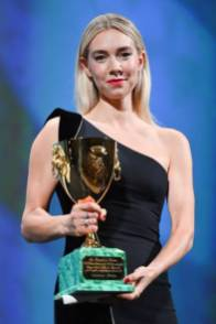 """British actress Vanessa Kirby acknowledges receiving the Coppa Volpi for Best Actress for """"Pieces of a Woman"""" during the closing ceremony on the last day of the 77th Venice Film Festival, on September 12, 2020 at Venice Lido, during the COVID-19 infection, caused by the novel coronavirus. (Photo by Alberto PIZZOLI / AFP) (Photo by ALBERTO PIZZOLI/AFP via Getty Images)"""