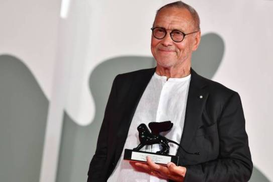 """Russian director Andrei Konchalovsky poses with the Special Jury Prize he received for """"Dear Comrades !"""" during the Winners' Photocall on the last day of the 77th Venice Film Festival, on September 12, 2020 at Venice Lido, during the COVID-19 infection, caused by the novel coronavirus. (Photo by Tiziana FABI / AFP) (Photo by TIZIANA FABI/AFP via Getty Images)"""