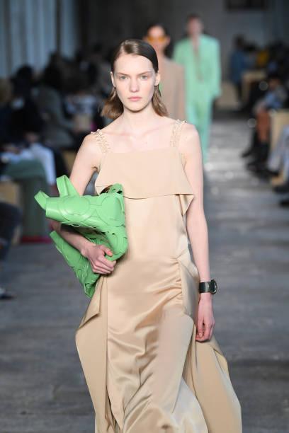 MILAN, ITALY - SEPTEMBER 25: A model walks the runway at the HugoBoss fashion show during the Milan Women's Fashion Week on September 25, 2020 in Milan, Italy. (Photo by Daniele Venturelli/Daniele Venturelli/WireImage )