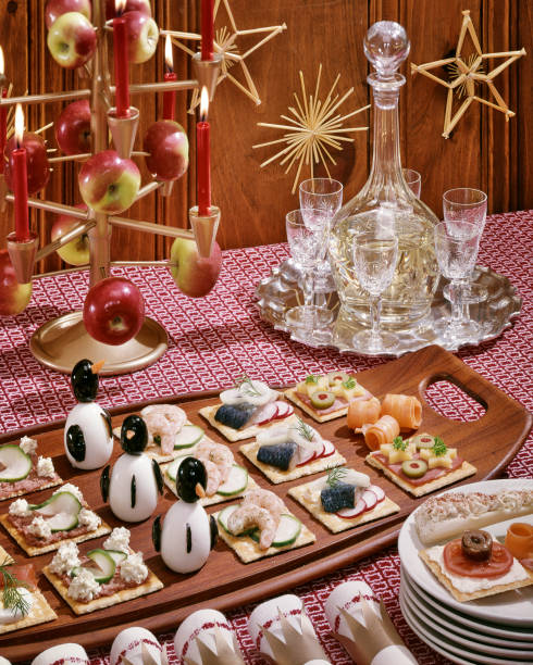 1950s 1960s SMORGASBORD HORS D'OEUVRES WITH SCANDINAVIAN CHRISTMAS APPLE TREE PENGUINS MADE FROM OLIVES HARD BOILED EGGS (Photo by L. FritzL. Fritz/ClassicStock/Getty Images)