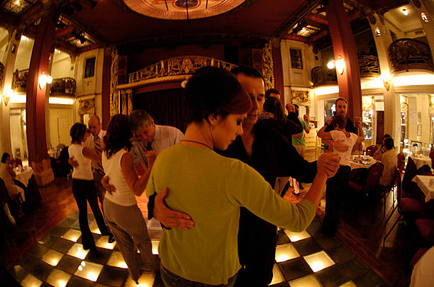 "Couples dance during a late afternoon tango lesson at ""Piazzolla"", which is devoted to tango and the memory of the great composer and interpreter Astor Piazzolla. It is also one of the best places for observers to see the Tango being danced and taught in Buenos Aires. (Photo by Horacio Villalobos/Corbis via Getty Images)"