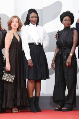 """VENICE, ITALY - SEPTEMBER 07: Maëlle Genet, Director Ellie Foumbi and Babetida Sadjo attend the red carpet of the movie """"Vidblysk"""" during the 78th Venice International Film Festival on September 07, 2021 in Venice, Italy. (Photo by Vittorio Zunino Celotto/Getty Images)"""
