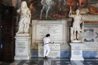 ROME, ITALY - MAY 19: A restorer cleans the base of a statue on the first day of opening of the Capitoline Museums after more than two months of lockdown on May 19, 2020 in Rome, Italy. Museums, restaurants, bars, cafes, hairdressers and other shops have reopened, subject to social distancing measures, after more than two months of a nationwide lockdown meant to curb the spread of Covid-19. Churches are starting to celebrate Mass again, but there will be strict social distancing and worshippers must wear face masks. And citizens will no longer be required to justify their movements with self-certification. (Photo by Marco Di Lauro/Getty Images)