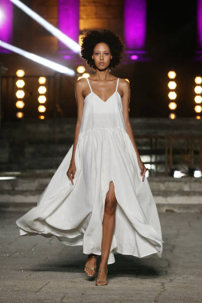 ROME, ITALY - JULY 09: A model walks the runway wearing a Chiara Perrot dress at the Rome Is My Runway #2 fashion show during Altaroma 2021 at Cinecitta Studios on July 09, 2021 in Rome, Italy. (Photo by Elisabetta Villa/Getty Images)