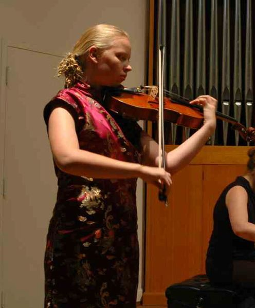 A mathematician plays viola. My musical education had an impact on my mathematical training in  ways I don't quite understand. This picture from my senior viola recital was taken by Gary White.