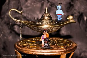 Genie figurines with a magic lamp