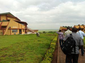 Walking to the auditorium at the IMSP, in Dangbo, Benin.