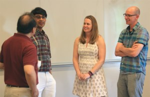 Manjul talking to math faculty after the Math Major Lunch. Left to right: Peter Wong, Manjul Bhargava, Katharine Ott, and Martin Montgomery.