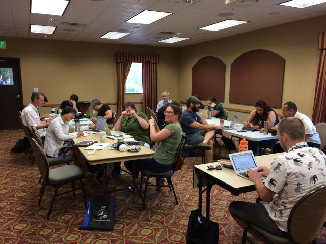 The group learning about algebraic stacks from an article by Kai Behrend. This photo was taken in the last week so people are being a little more silly than usual (but only a little).