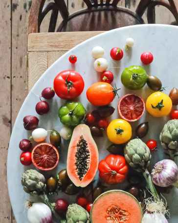 various fresh vegetables and fruits on table