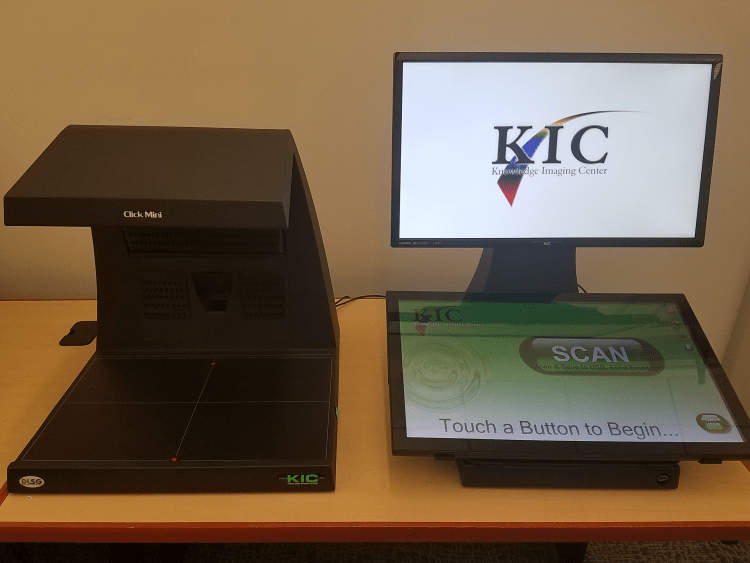 picture of our new awesome scanner. Press a button to scan documents