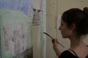 Babson student Amy Dwarnick puts the finishing touches on a fresh layer of plaster, continuing a 2,000 year-old Italian tradition of buon fresco, for their class in Fresco at the Umbra Institute in Perugia.