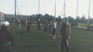 Students learning to play Hurling