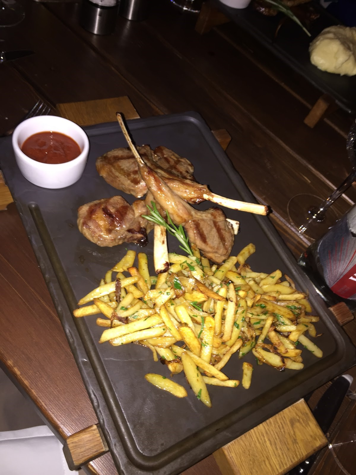 Here we see the big Russian portions of their meals. Rack of lamb and baked fries with onions! Also, a picture of some BRICers dining, the menus are also very extensive.