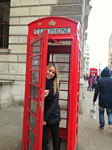 Student in phone booth in England