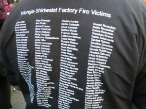 Some people at the observance wore T-shirts that listed the names of those who died in the Triangle fire.