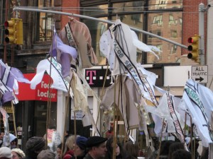 To commemorate those who died in the Triangle Shirtwaist Factory, marchers carried shirts aloft.