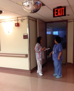 Gema Santos and Jennifer Cabero outside of a patient's room at Bellevue Hospital. Photo by Roxanne Torres