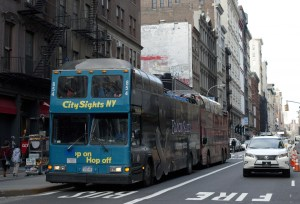 Tour buses regulat deposit out-of-towners in Soho, adding to the congestion. Photo by Emma Kazaryan
