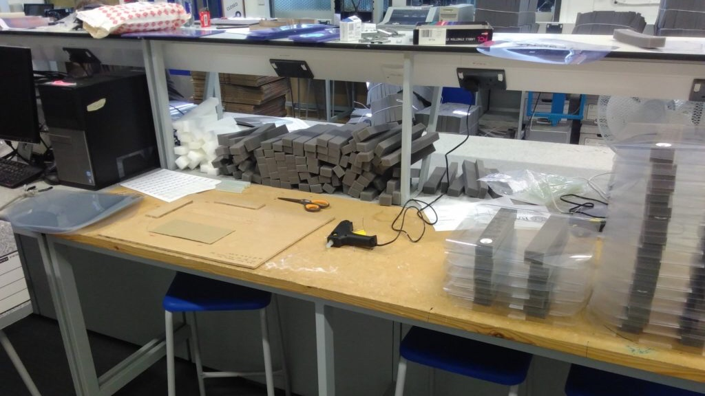 A workstation in the Mech Eng teaching lab where face shields are being made.
