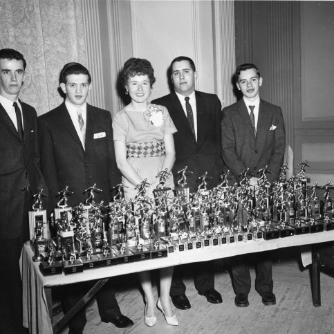 Bowling Team members with awards at their annual banquet, ca. 1950s.